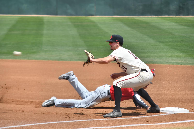 Junior first baseman Jordan Verdon attempts to pick off UNLV's Bryson Stott during the Aztecs 4-2 victory over the Rebels on April 29 at Tony Gwynn Stadium.