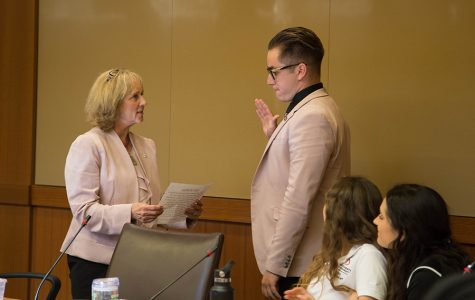 San Diego State President Sally Roush administers the oath of office to incoming Associated Students President Chris Thomas.