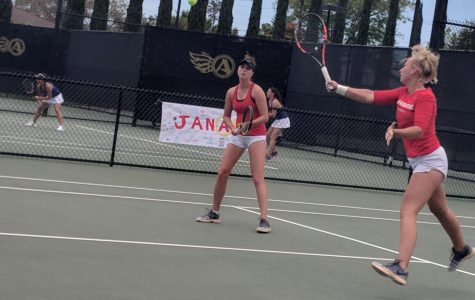 Sophomore Mia Smith (right front) and junior Jenny Moinard compete in doubles during the Aztecs 4-3 loss to San Jose State at the Aztec Tennis Center on April 21.