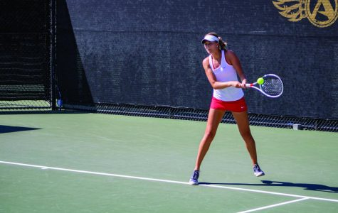 Senior Jana Buth goes for a hit during the Aztecs 4-1 victory over University of San Francisco at the Aztec Tennis Center on April 8.