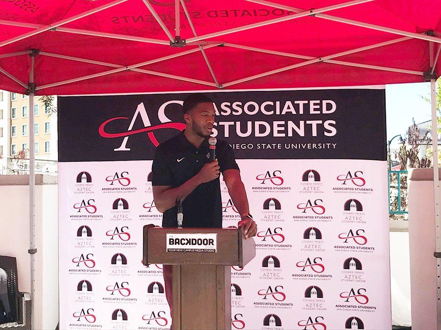 A.S. President Chimezie Ebiriekwe speaks at the grand opening of The Backdoor Room, the university's new media studio.