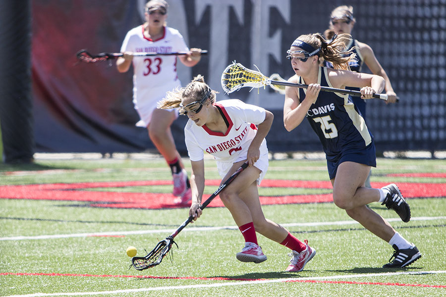 Freshman Julia Sheehan goes for the ball during the Aztecs 15-9 loss to UC Davis at the Aztec Lacrosse Field on April 8.