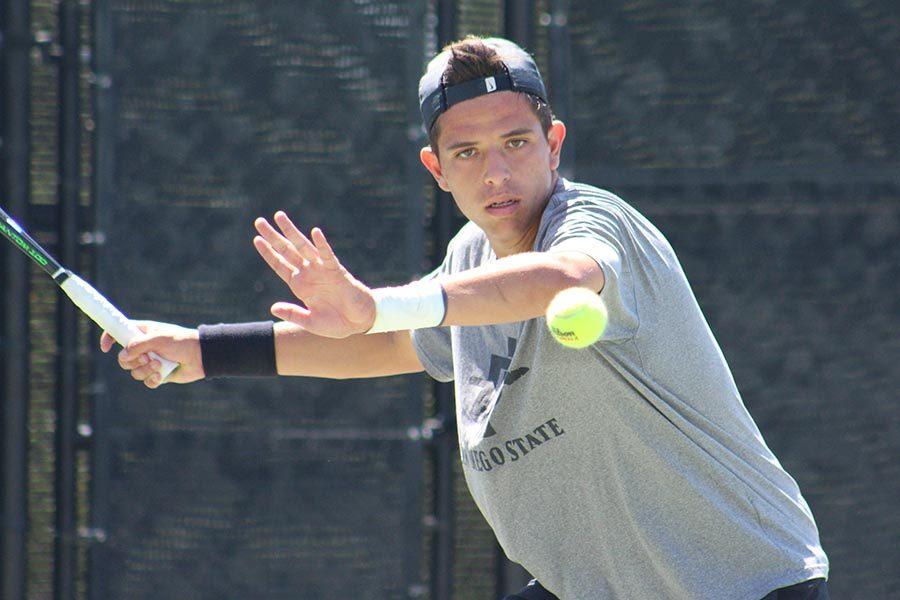 Sophomore Rafael Gonzalez Almazan prepares to swing his racket during the Aztecs 4-3 victory over Nevada at the Aztec Tennis Center on April 13.