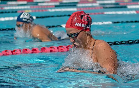 Redshirt freshman Gianna Haugen competes during the Aztecs meet with San Diego on April 20 at the Aztec Aquaplex.