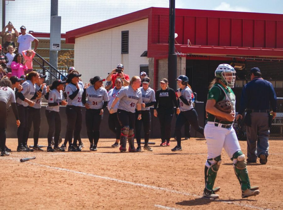 Sophomore shortstop Shelby Thompson runs towards her teammates at home plate after hitting a walk-off home run during the Aztecs 3-2 victory over Colorado State on April 29 at SDSU Softball Stadium.