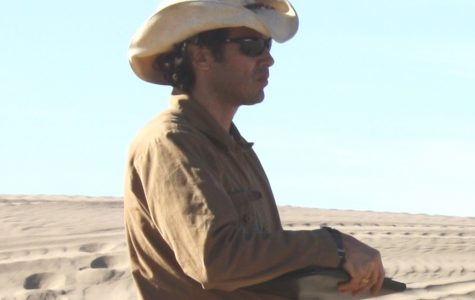 Seth Mallios surveys old movie set sites from the 1920s and '30s at Buttercup Dunes in Imperial County, CA.