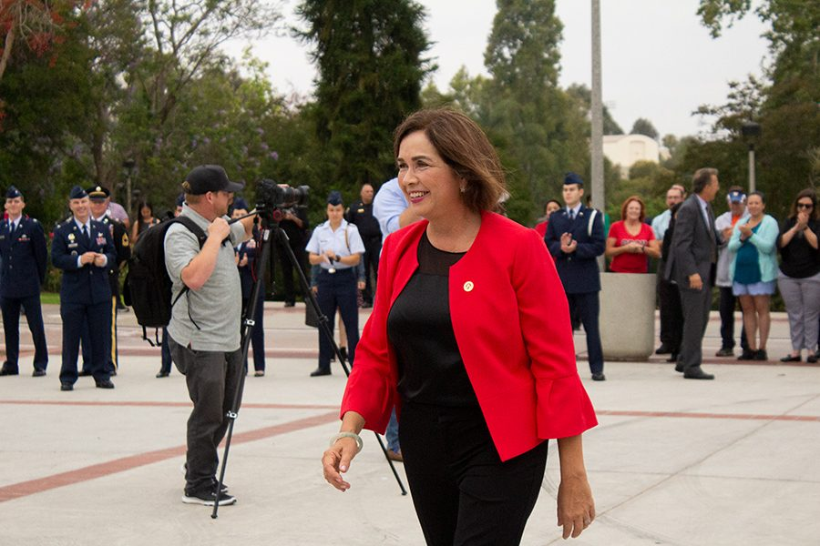 San Diego State President Adela de la Torre walks toward guests after a flag raising ceremony in June 2018.