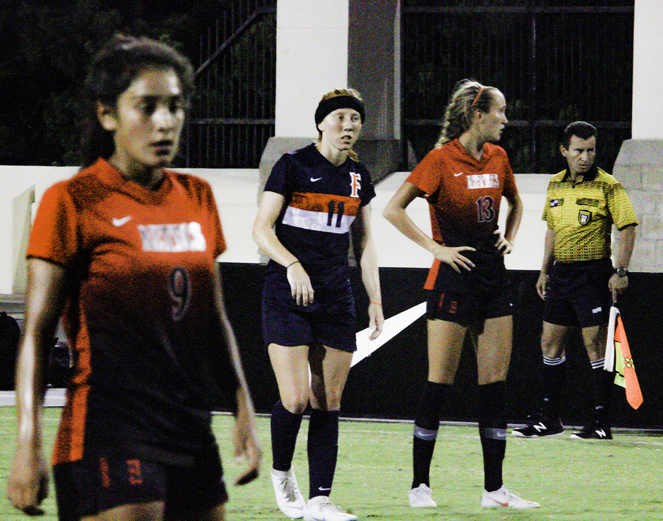 (left to right) Aztecs freshman midfielder Laura Fuentes, CSUF sophomore midfielder Haley Brown and SDSU freshman defender Lauren Dicus stand on the pitch during a break in the action of an exhibition match on Aug. 10 at the SDSU Sports Deck. The Aztecs lost the match 2-1.