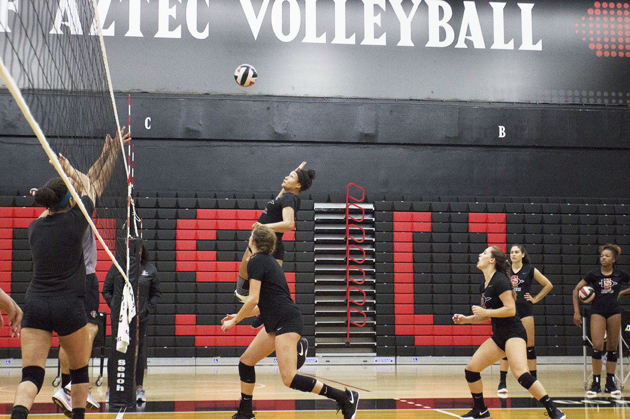Senior Deja Harris goes up for a spike during practice at Peterson Gym on Aug. 21.