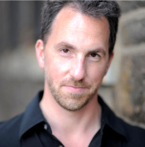 Associate professor Patrick Walders in a headshot for SDSU's music department's staff website.