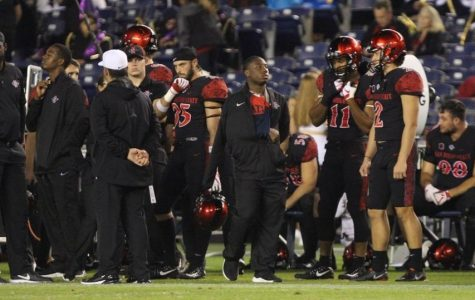 Junior running back Juwan Washington stands on the sidelines with his arm in a sling during the second half of the Aztecs 23-20 victory over Eastern Michigan on Sept. 22 at SDCCU Stadium.