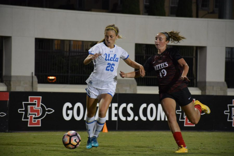SDSU sophomore forward Mia Root (right) goes for the ball against UCLA redshirt sophomore midfielder Meghan Scudero (left) during the Aztecs' 3-0 loss to the Bruins on Sept. 16 at the SDSU Sports Deck.