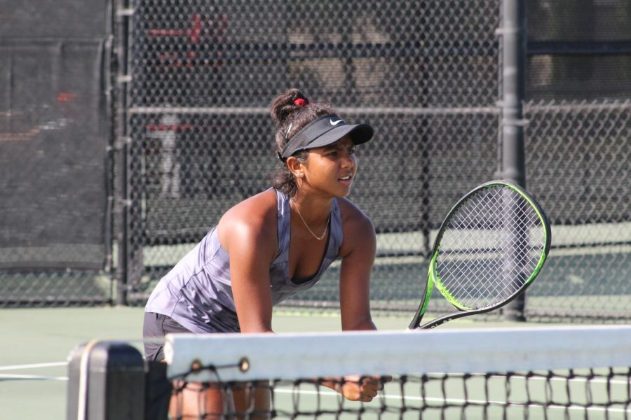 Freshman Aesha Patel readies for a service during a doubles match against UTEP on Sept. 30 at the Aztec Tennis Center.