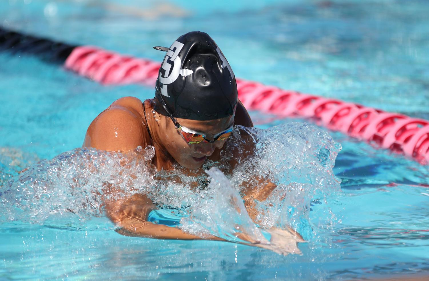 Sophomore swimmer Larisa Tam competes in the 100-yard IM event during the Aztecs' first meet of the season against University of San Diego on Sept. 14 at the Aztec Aquaplex.