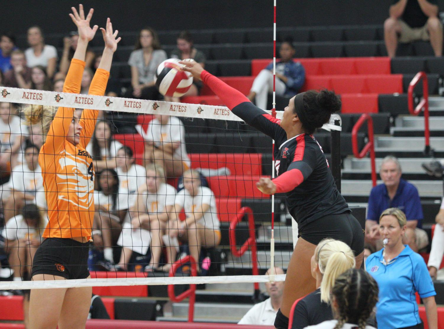 Senior middle blocker Deja Harris spikes the ball during the Aztecs four-set loss to Oregon State on Sept. 14 at Peterson Gym.