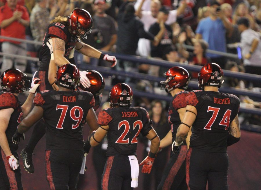Junior tight end Parker Houston is lifted up in the end zone by his teammates after catching a second quarter touchdown during the Aztecs 23-20 victory over Eastern Michigan on Sept. 22 at SDCCU Stadium.