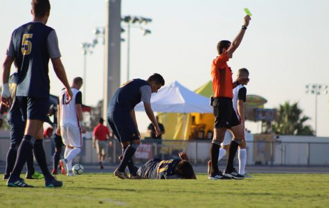 The referee shows SDSU a yellow card during the Aztecs 2-1 victory over UC Irvine on Sept. 9 at the SDSU Sports Deck.
