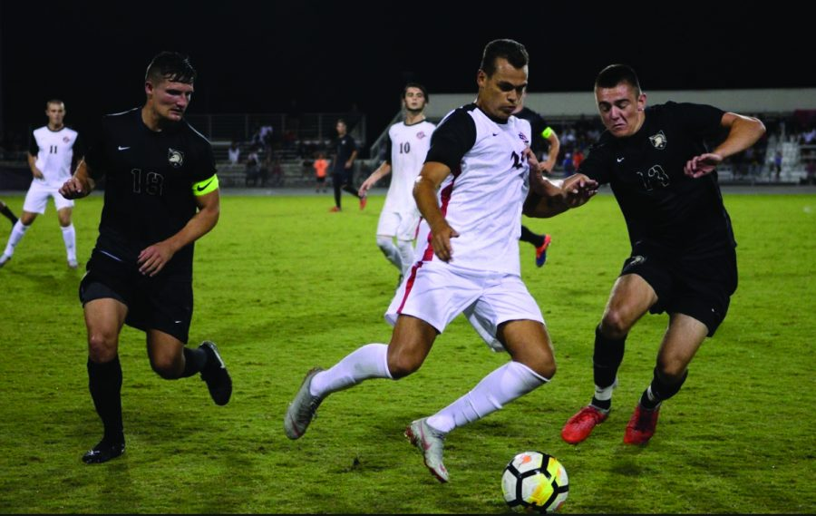 Then-sophomore midfielder Tevenn Roux dribbles the ball between two Army players during the Aztecs 2-1 loss to Army on Sept. 1, 2018 at the SDSU Sports Deck.