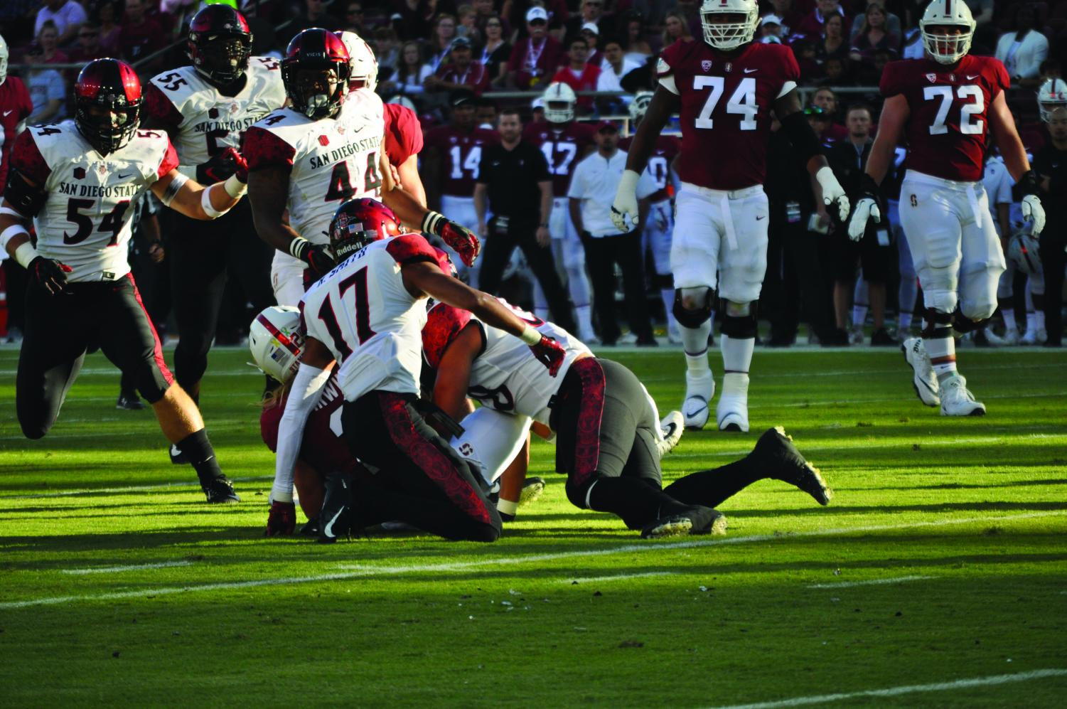 Junior cornerback Ron Smith (17) and sophomore linebacker Andrew Aleki tackle Stanford senior wide receiver Trenton Irwin following a catch during the Aztecs 31-10 loss to Stanford on Aug. 31 at Stanford Stadium.