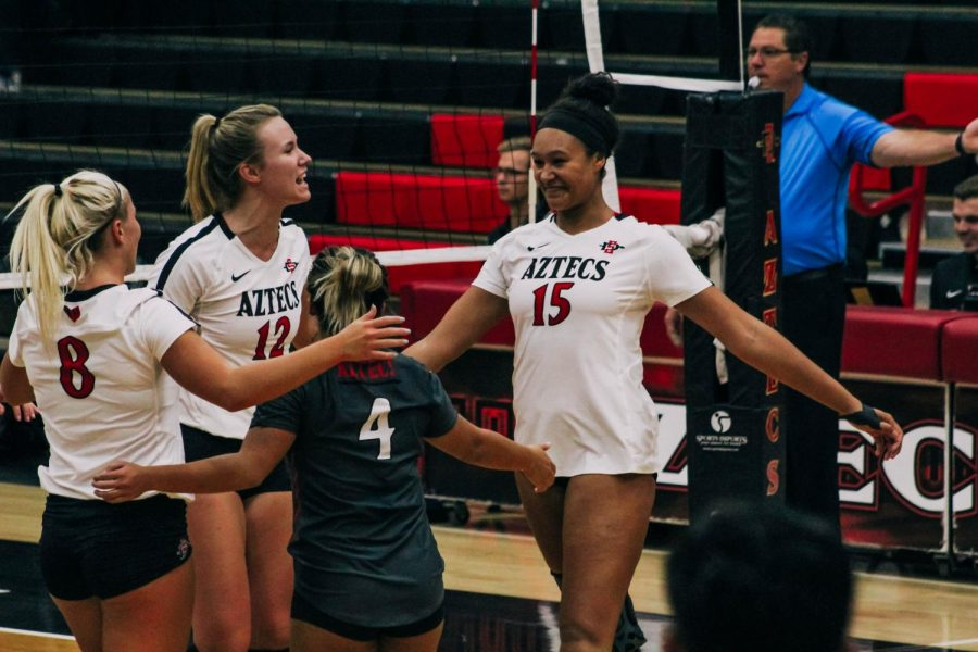 Senior+middle+blocker+Deja+Harris+%28right%29+celebrates+with+her+teammates+after+earning+a+point+during+the+Aztecs+five-set+loss+to+Louisiana+on+Sept.+15+at+Peterson+Gym.