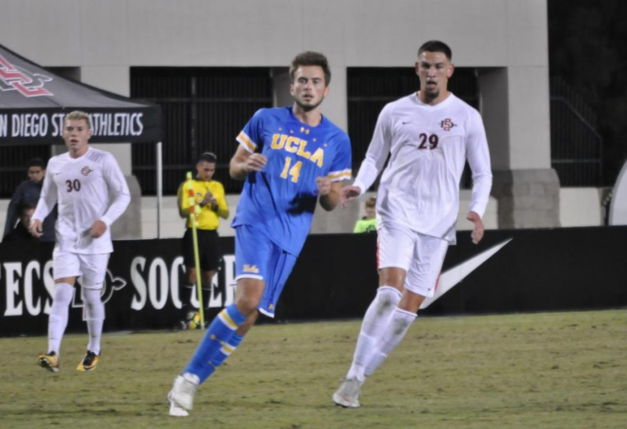 SDSU+junior+midfielder+AJ+Valenzuela+and+UCLA+sophomore+defender+Eric+Iloski+chase+down+the+ball+during+UCLA%27s+2-1+victory+over+the+Aztecs+on+Oct.+13+at+the+SDSU+Sports+Deck.