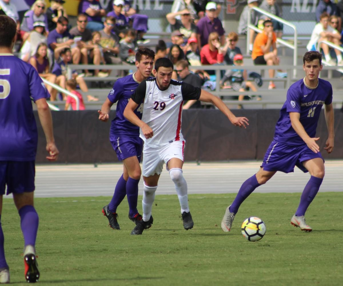 Then-junior midfielder AJ Valenzuela chases after the ball during the Aztecs' 2-1 loss to Washington on Oct. 7, 2018 at the SDSU Sports Deck.