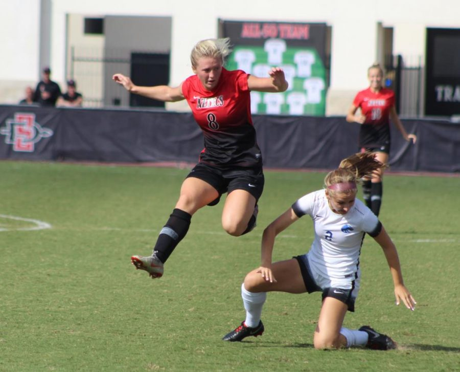 Sophomore+forward+Chloe+Frisch+leaps+around+a+Boise+State+defender+during+the+Aztecs+1-0+loss+to+the+Broncos+on+Oct.+7+at+the+SDSU+Sports+Deck.