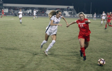 SDSU freshman defender Lauren DIcus (left) chases after the ball with Lobos sophomore midfielder Jenna Killman during the Aztecs 3-1 loss on Oct. 26 at the SDSU Sports Deck.
