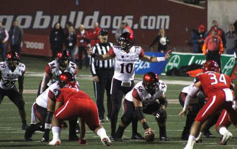 Senior quarterback Christian Chapman prepares for the snap during the Aztecs' 23-14 loss to Fresno State on Nov. 17 at Bulldog Stadium.