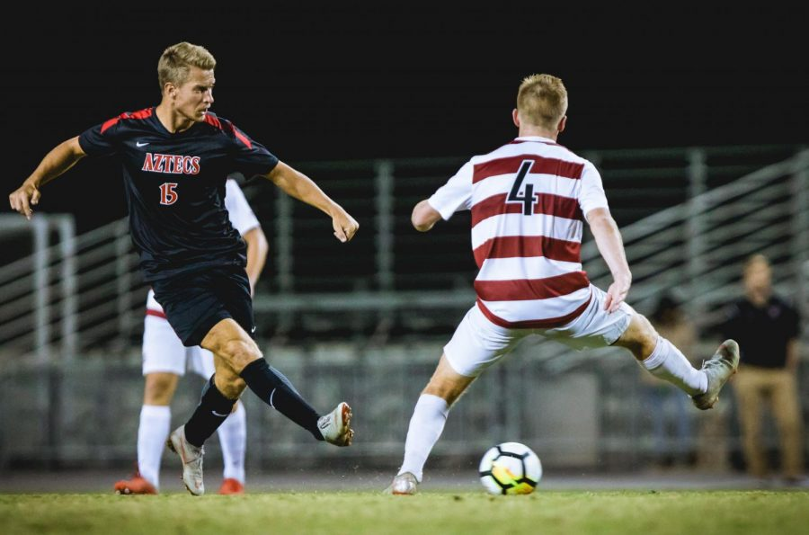 Junior+midfielder+Hampus+Bergdahl+attempts+to+kick+the+ball+around+a+Stanford+defender+during+the+Aztecs+2-0+loss+to+the+Cardinal+on+Nov.+4+at+the+SDSU+Sports+Deck.