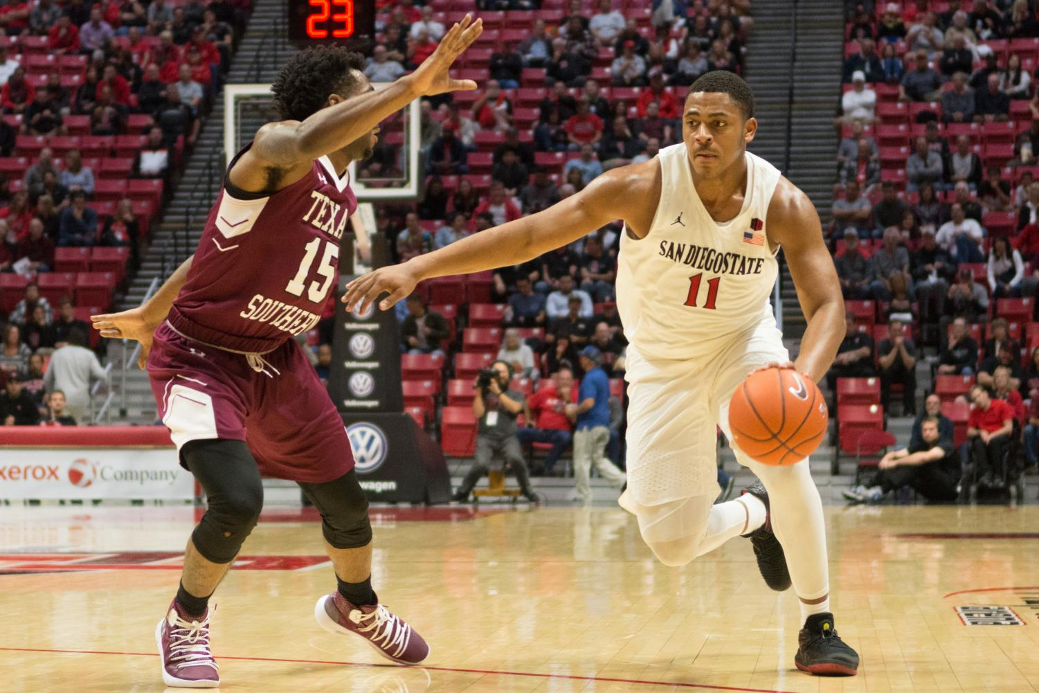 Sophomore forward Matt Mitchell drives around redshirt sophomore forward Justin Hopkins during the Aztecs 103-64 victory over Texas Southern on Nov. 14 at Viejas Arena.