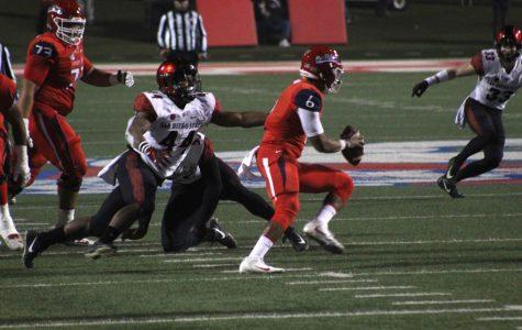 SDSU junior linebacker Kyahva Tezino sacks Fresno State quarterback Marcus McMaryion in the Aztecs' 23-14 loss on Nov. 17 at Bulldog Stadium.