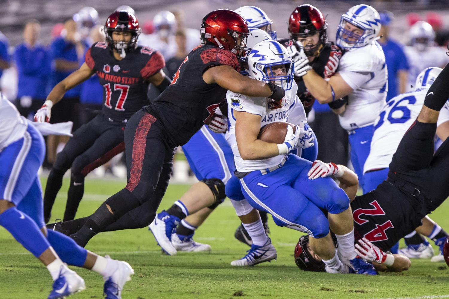 Senior defensive lineman Anthony Luke takes down an Air Force ball carrier on Oct. 12 at SDCCU Stadium.