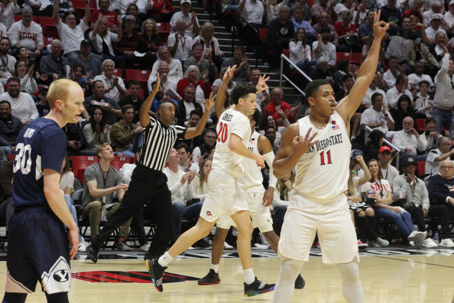 Sophomore forward Matt Mitchell throws up three fingers after knocking down a shot from behind the arc during the first half of the Aztecs 90-81 victory over BYU on Dec. 22 at Viejas Arena. Mitchell finished with 22 points.