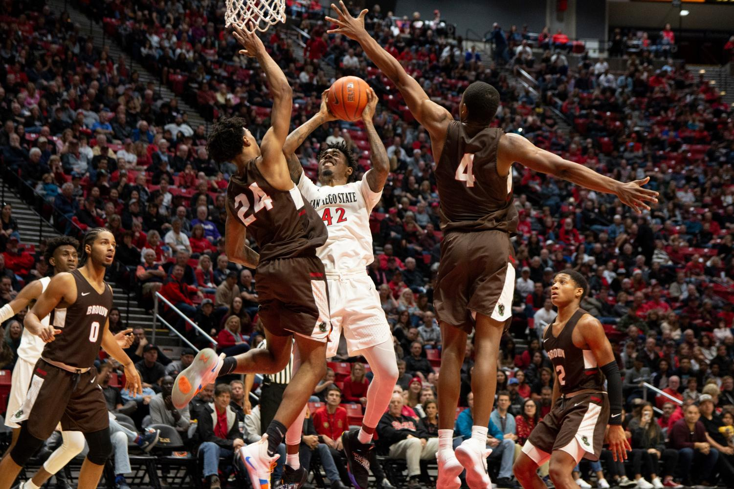 6d91d2cfdce71c Senior guard Jeremy Hemsley attempts a shot against two Brown defenders  during the Aztecs 82-