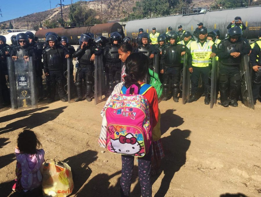A+migrant+child+stands+in+front+of+Mexican+police+in+Tijuana%2C+Mexico+on+Sunday%2C+Nov.+25+during+a+protest+at+the+border.