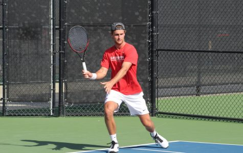 Senior Sander Gjoels-Anderson prepares to swing his racket during his singles match against Mateusz Smolicki. Gjoels-Anderson win helped the Aztecs defeated UC Irvine, 4-3, at the Aztec Tennis Center on Jan. 26.