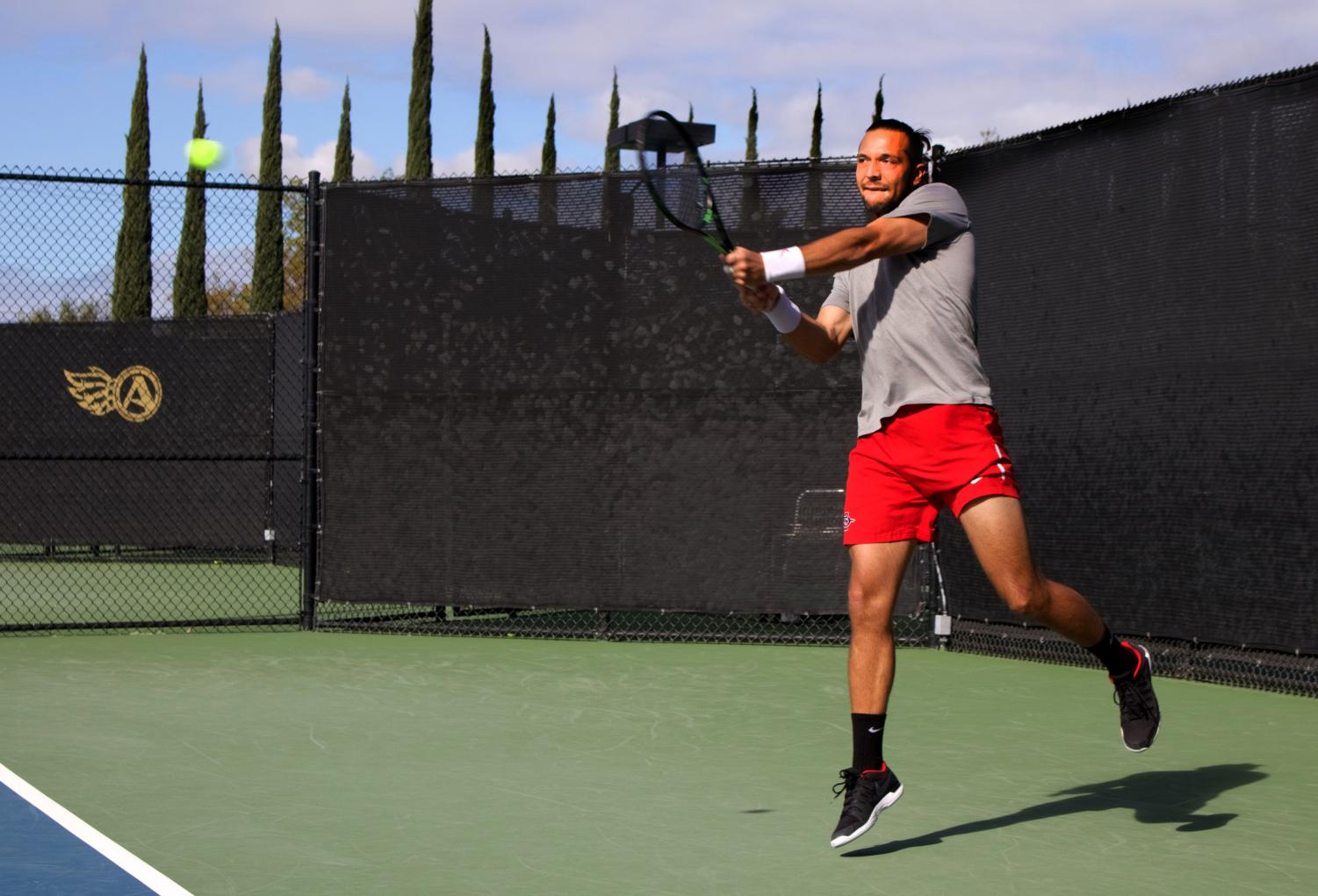 Junior Fabian Roensdorf competes during the Aztecs 4-3 loss to Northern Arizona on Feb. 10 at the Aztec Tennis Center.