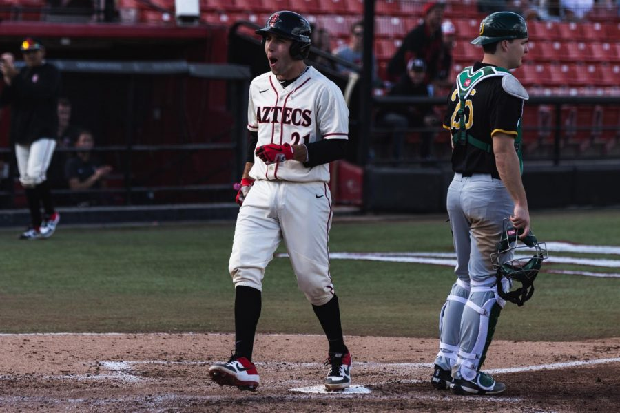 Then-freshman infielder Brian Leonhardt steps on home plate to score a run during the Aztecs 9-8 loss to San Francisco on Feb. 16, 2019 at Tony Gwynn Stadium.