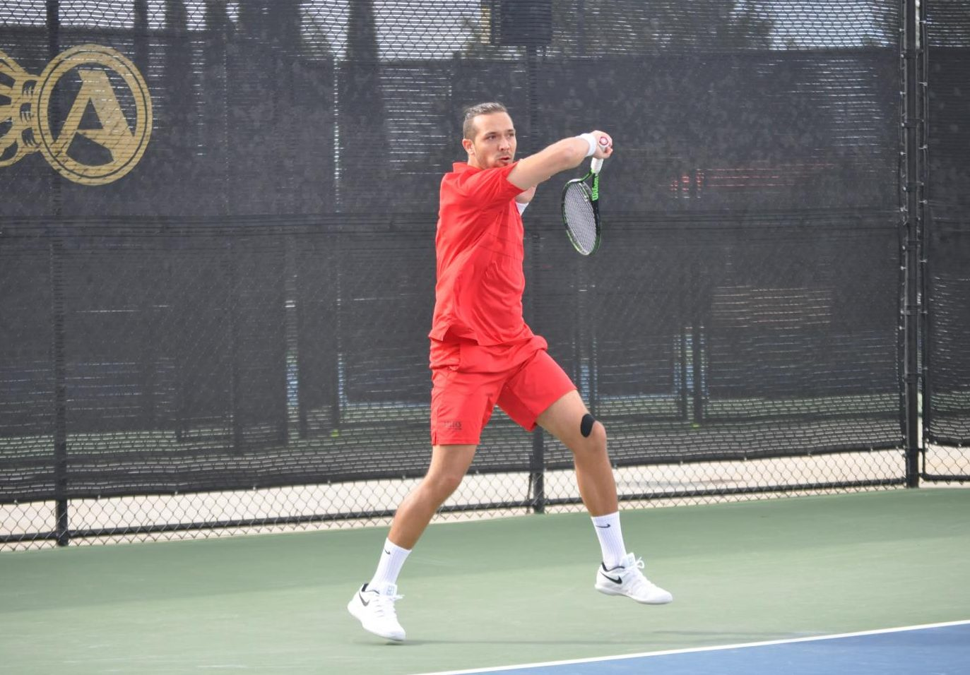 Junior Fabian Roensdorf swings his racket during the Aztecs' 4-3 victory over San Francisco on Feb. 17 at  the Aztec Tennis Center.