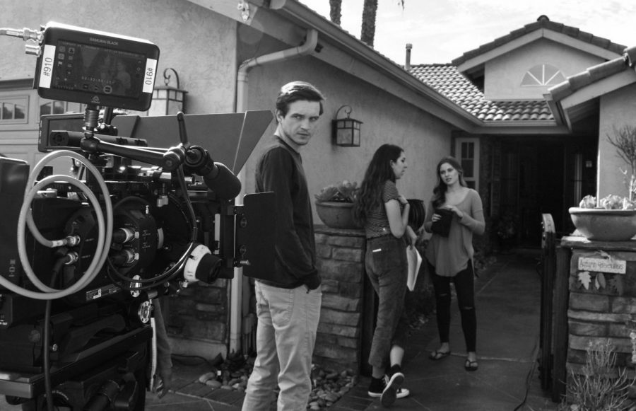"""Erin Martinez, Ross Graham and Isabella Mangione work behind the scenes of """"Alone Together."""""""