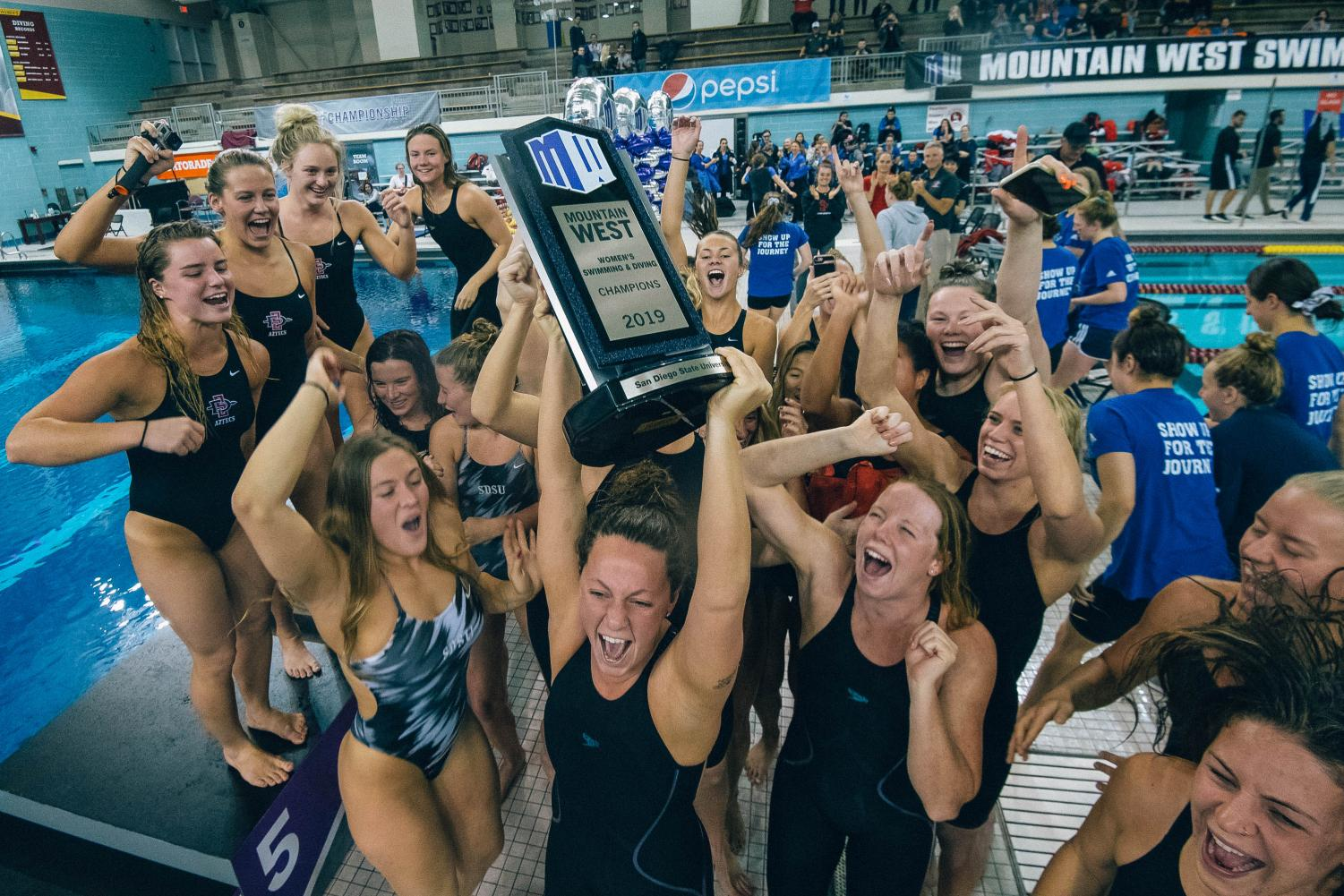 The Aztecs hoist up the Mountain West Championship trophy on Feb. 23 at the Jean K. Freeman Aquatic Center in Minneapolis.