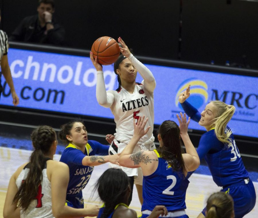 Sophomore guard Téa Adams shoots over multiple SJSU defenders during the Aztecs' 69-68 victory over the Spartans on Feb. 2 at Viejas Arena.