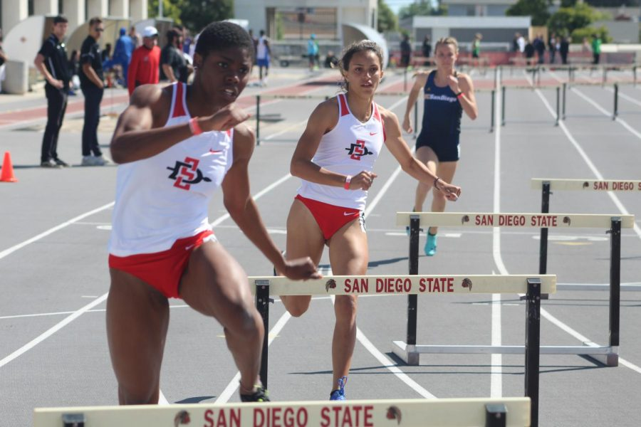 Freshman hurdler Nia Collins (front left) and sophomore hurdler Mia Brosch (middle) compete in the 400 meter hurdles during the Aztec Open & Invitational on March 23 at the Aztrack Sports Deck.