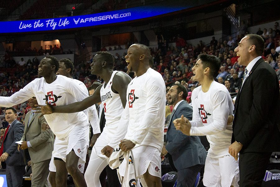 San Diego State's bench cheers after a three-pointer by the Aztecs during their game against UNLV on March 14.