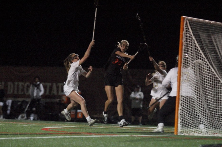 Sophomore midfielder Bailey Brown takes a shot during the Aztecs 15-14 victory over Vanderbilt on March 8 at the SDSU Lacrosse Field.