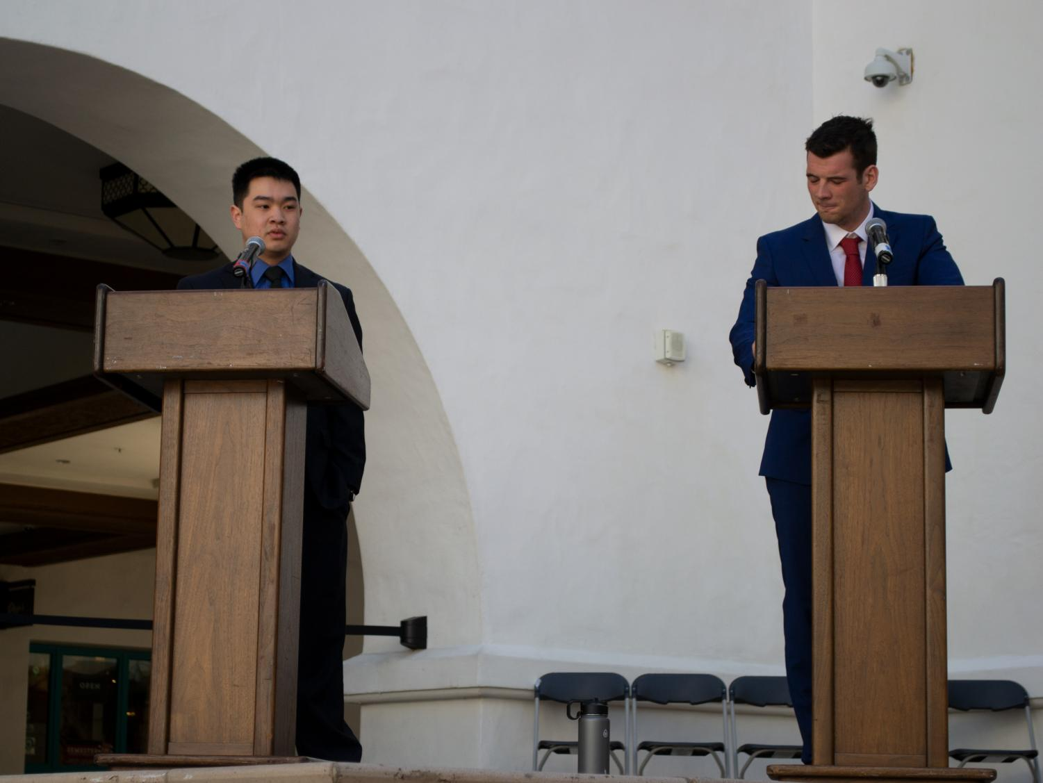 Vice President of University Affairs candidates Winston Liew (left) and George Scott square off in front of students at the Conrad Prebys Aztec Student Union on the afternoon of Monday, March 18.