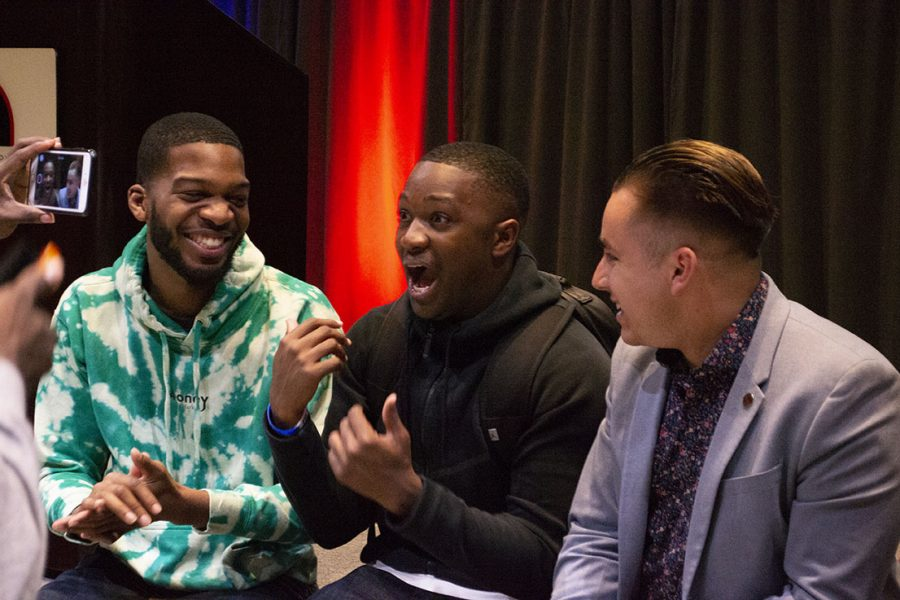 From left to right: former A.S. president Chimezie Ebiriekwe, A.S. president-elect Christian Onwuka and current A.S. President Chris Thomas celebrate Onwuka's victory at Montezuma Hall Thursday night. The Vote SDSU slate, headed by Onwuka, swept this year's A.S. elections.