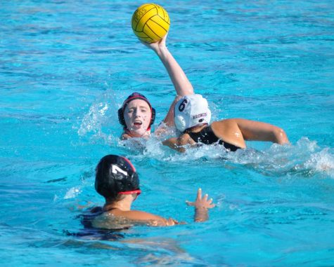 Emily Bennett, during her sophomore season, attempts to pass the ball to utility player Shelby Kraft during the Aztecs