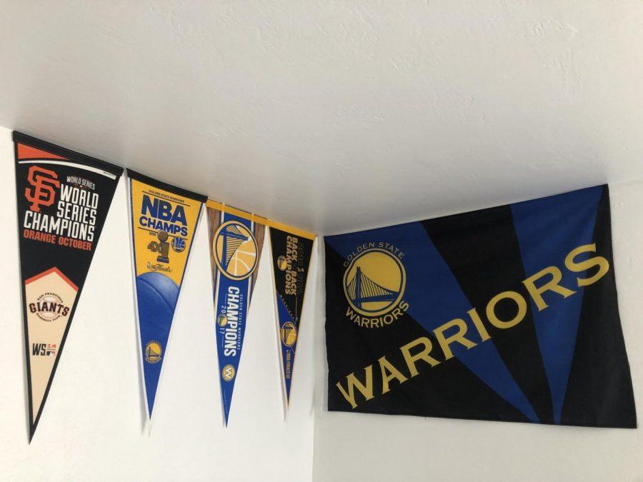 Tolentino represents his favorite teams with his wall décor.